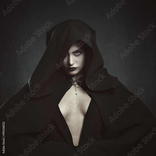 Mysterious hooded vampire woman