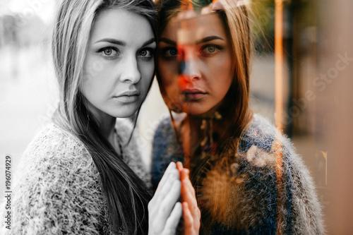 Fototapeta Self reflection portrait of amazing young girl in mirrored window