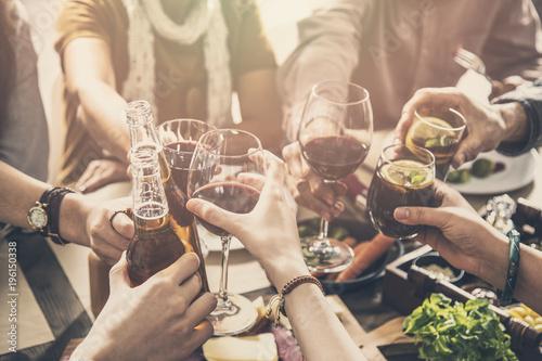 Fotografie, Obraz Group of people having meal togetherness dining toasting glasses