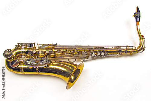 Canvas Print Old golden saxophone on white background