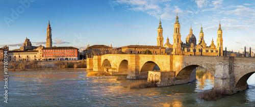 Zaragoza - The panorama with the bridge Puente de Piedra and Basilica del Pilar in the morning light.