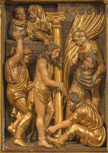 Fotografiet ZARAGOZA, SPAIN - MARCH 3, 2018: The polychome carved renaissance relief of Flagelation of Jeus in church  Iglesia de San Miguel de los Navarros by Damian Forment (1519)