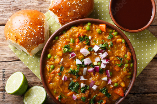 Indian street food Pav bhaji vegetables close-up in a bowl. horizontal top view