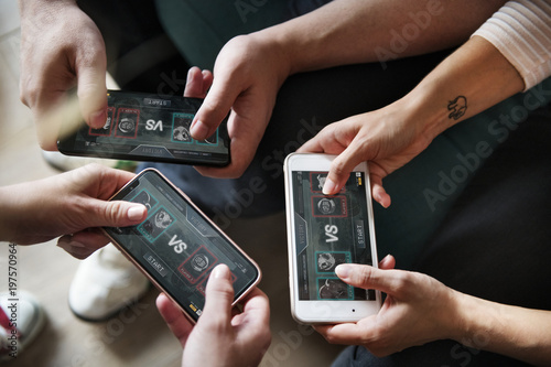 Wallpaper Mural Group of diverse friends playing game on mobile phone