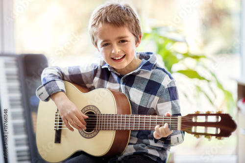 Boy playing acoustic guitar