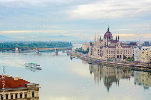 Fototapeta Quite Danube river, floating cruise ship, Parliament building