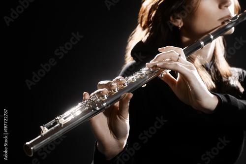 Slika na platnu Flute instrument. Flutist hands playing flute music