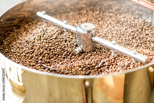 Close-up view on the roasted coffee beans cooling in the roaster machine Fototapeta