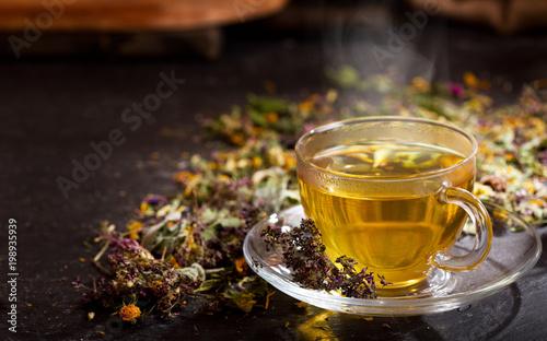 Fotografie, Obraz Cup of herbal tea with various herbs