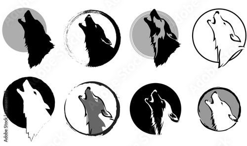 Fototapeta premium set of stylized images of a wolf glory wailing at the moon, black and white variants, vector illustration, isolated objects