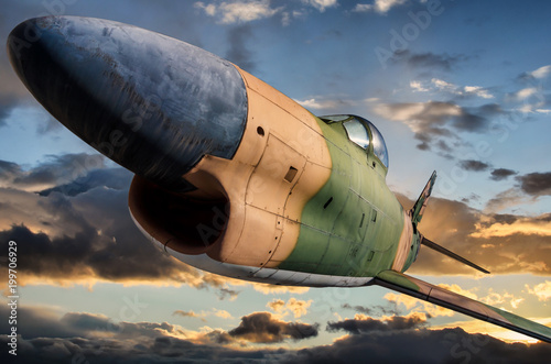 Tableau sur Toile The North American F-86D Sabre Dog in flight at sunset time