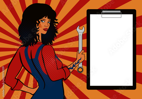 фотография Pop art, black-haired girl mechanic with a spanner