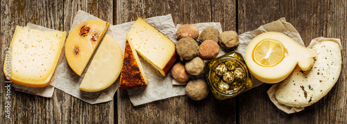 Various types of cheese on wooden table. Top view. Copy space.