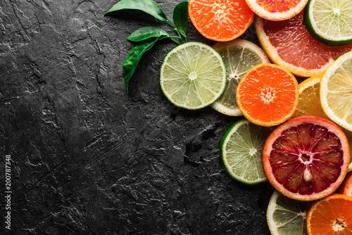 Leinwand Poster Mix of different citrus fruits closeup