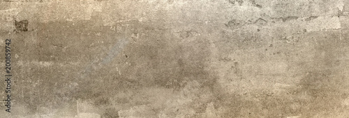 Tekstura betonowej ściany XXL, na której niektóre światło słoneczne pada jako tło
