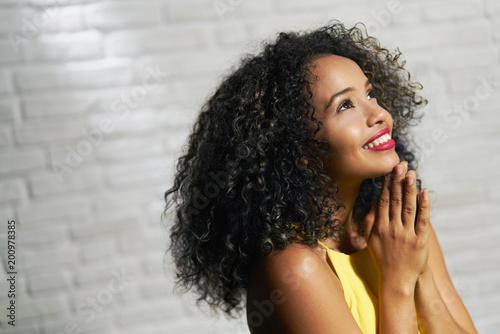 Valokuva Facial Expressions Of Young Black Woman On Brick Wall