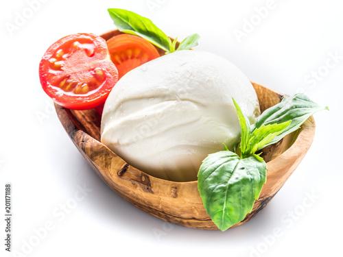 Buffalo mozzarella in the wooden bowl on white background.