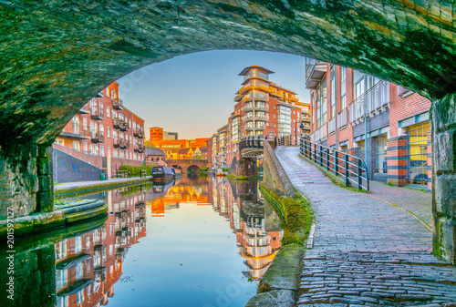 Sunset view of brick buildings alongside a water channel in the central Birmingham, England