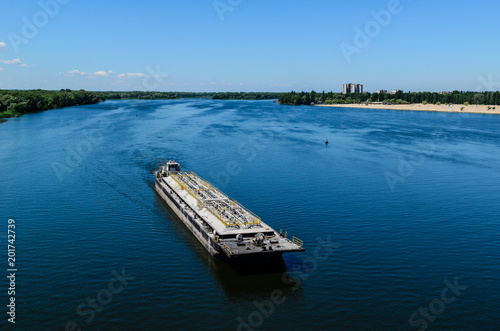 Leinwand Poster Oil product tanker barge on river Dnieper