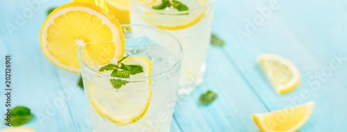 Fotografie, Tablou Refreshing drinks for summer, cold  lemonade juice with sliced fresh lemons