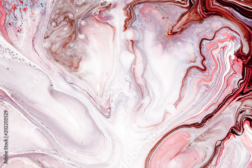 Swirls of marble or the ripples of agate. Liquid marble texture with pink, white and brown colors. Abstract painting background for wallpapers, posters, cards, invitations, websites. Fluid art.