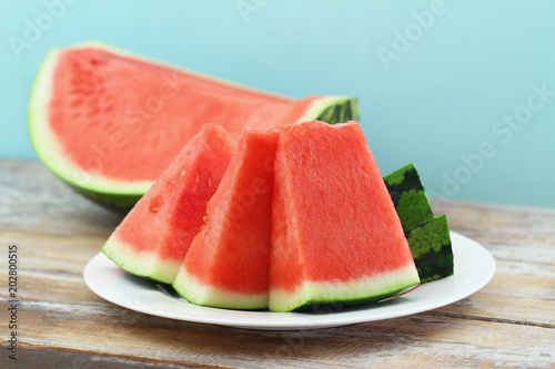 Slices of fresh watermelon on white plate