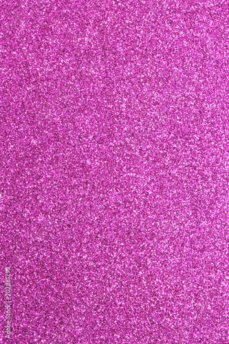 Magenta glitter background in reflective and shimmering material