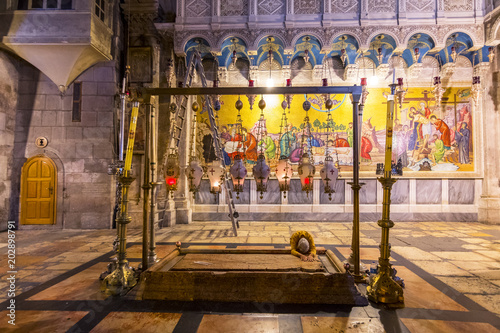 Canvas Print Pilgrim prays at the Stone of Anointing or the Stone of Unction, Church of the Holy Sepulchre in Jerusalem, Israel, Middle East