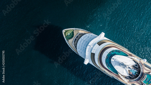 Fotografering Aerial view beautiful large cruise ship at sea, Big blue passenger cruise liner ship vessel sailing across the Gulf of Thailand go to the beach