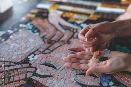 Fotografie, Obraz Female hands with mosaic