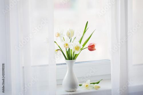 spring flowers in white vase