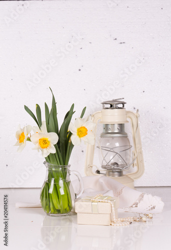Still life with flowers and a kerosene lamp