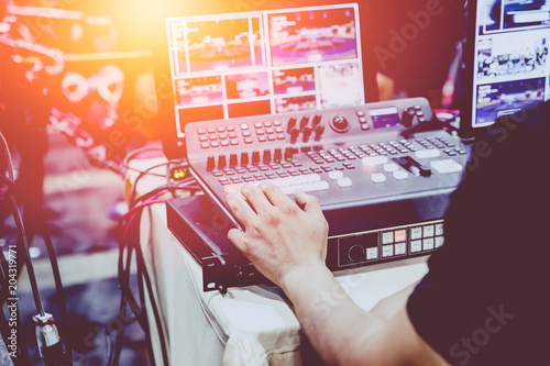 Professional video editor footage switching on stage duty vintage tone.