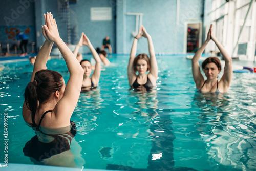 Female group on aqua aerobics in swimming pool