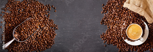 Obraz na plátne cup of coffee and coffee beans in a sack, top view