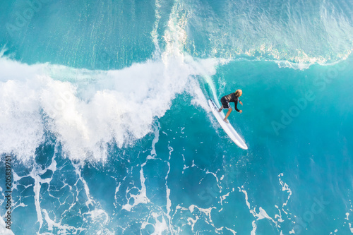 Surfer on the crest of the wave, top view