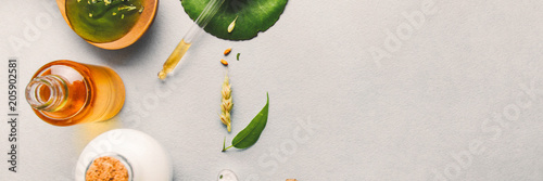 Natural cosmetics, oils for skin care on a light background. Homeopathic oils, whey, milk, soap. Beauty blogger concept.