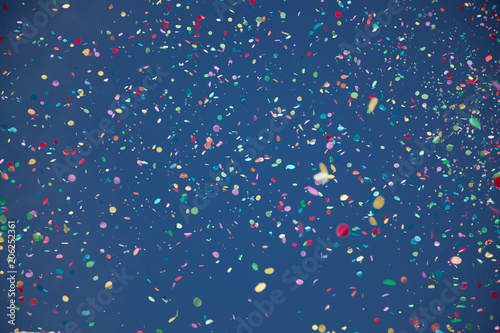 confetti falling during a festival or carnival in the city