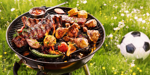 Summer or spring barbecue outdoors in a meadow Fotobehang