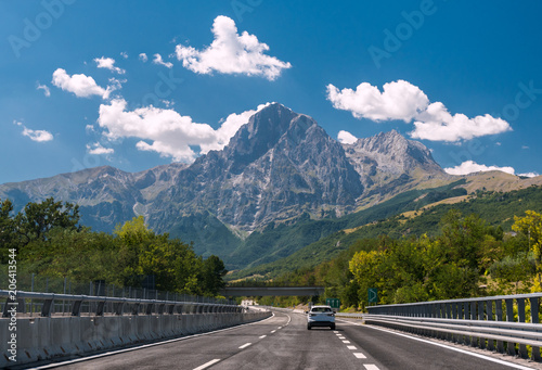 Fototapeta An highway in Italy; the mountain Gran Sasso in background