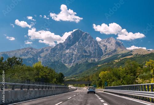 Valokuvatapetti An highway in Italy; the mountain Gran Sasso in background