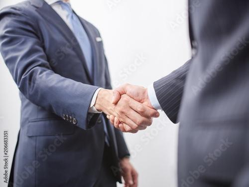 Murais de parede 握手をする男性ビジネスマン