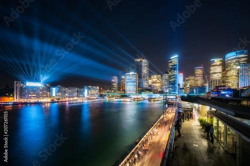 Colorful lights and lasers illuminate Sydney Skyline at Circular Quay for Vivid Festival 2018 in Sydney, Australia Tapéta, Fotótapéta