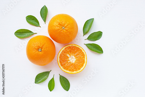 Vászonkép Fresh orange citrus fruit  with leaves on  white wooden background