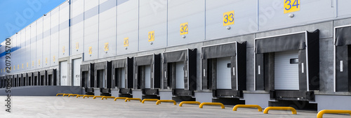 Canvas Print Entrance ramps of a large distribution warehouse with gates for loading goods