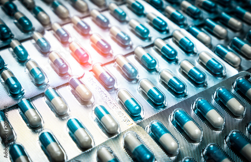 Fotografie, Tablou Blue and white capsules pill in blister pack arranged with beautiful pattern