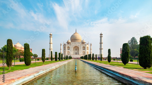 Fotografie, Obraz Taj Mahal front view reflected on the reflection pool, an ivory-white marble mausoleum on the south bank of the Yamuna river in Agra, Uttar Pradesh, India