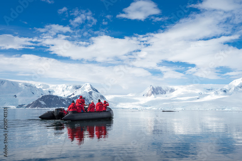 Tablou Canvas Inflatable boat full of tourists, watching for whales and seals, Antarctic Penin