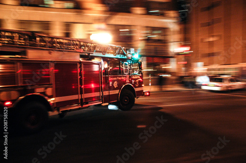 Fototapeta Chicago Fire Department (CFD) engine responds to emergency call