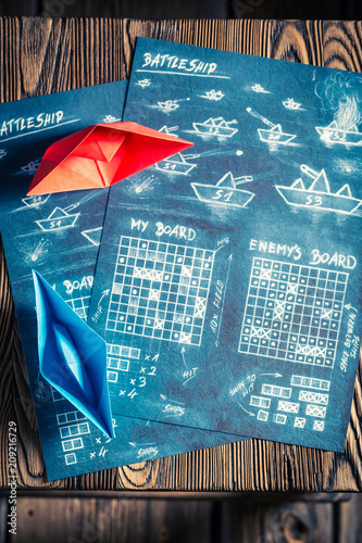 Battleship paper game ready to play and red ship Fototapeta